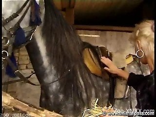 Blonde in sneakers gets fucked by a hung horse on cam
