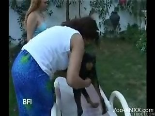 Tanned Latina sluts banging a big-dicked dog outdoors