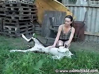 Pale brunette with a ponytail fucking a hung dog