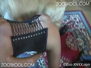 Tanned blonde in a corset gets fucked by a dog