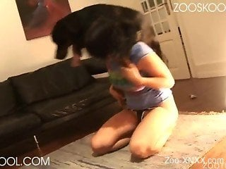 Jeans-wearing brunette gets fucked by a black dog