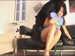 Black dog destroying this brunette's tight holes