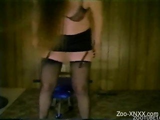 Stockings-wearing brown-haired chick blows a dog