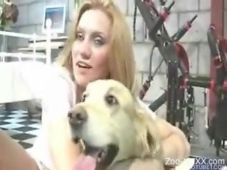 Blonde dressed in white fucking a white dog