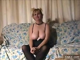 Collared mature lady takes this dog's cock