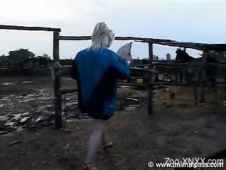 Blond-haired chick gets to suck a horse cock outdoors