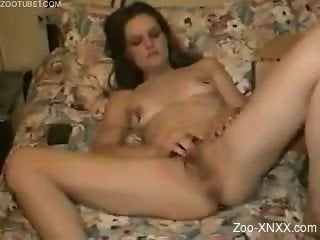 Skinny brunette with a hairy pussy masturbating