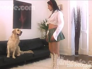 Astonishing zoophile in white boots her licked by the dog
