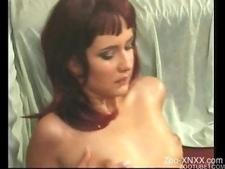 Redhead girl is lying on the carpet and sucking her doggy