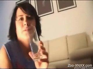 Dark-haired chick drinks fresh sperm of her lovely black dog