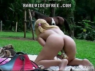 Blonde is sucking a tasty horse prick with passion and love