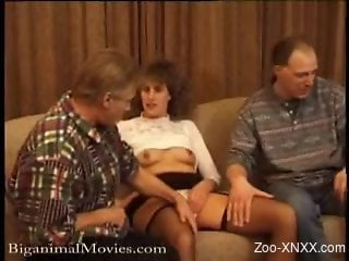 Two men and mistress invite dog in their threesome on couch