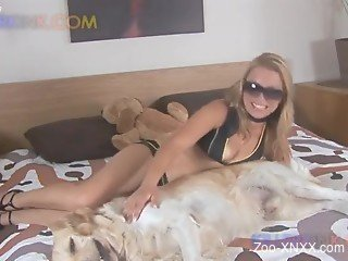 Tanned blonde enjoys large dog cock in her mouth