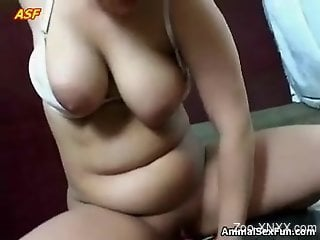 Chubby brunette rides a dog's meaty cock on a  bed