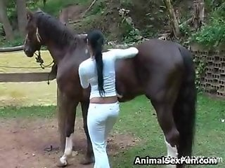 Ponytailed Latina strips to seduce a kinky pony