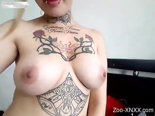 Tatted-up chick enjoying hardcore sex with a kinky dog