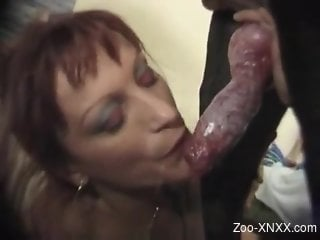 Mature filmed when gagging with the dog's penis