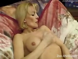 Blonde masturbates before banging a horny doggo