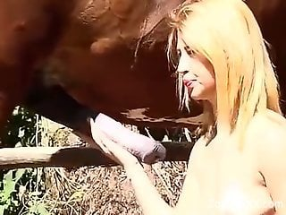 Blond-haired Latina spreads her legs for a horse