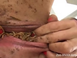 Leggy blond-haired MILF cums with a can of worms